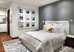 In this master bedroom, a Calligaris bed from Charles Eisen & Associates lifts up to provide storage underneath.