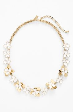 Layered petals with gold and glossy enamel bloom along this sweet Kate Spade collar necklace.