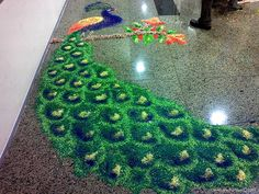 13 Amazing Peacock Rangoli Designs - Rangoli are decorative designs using rice, sand or flower petals. In India the folk art of Rangoli is done inside homes or outside in courtyards, especially during Hindu holy festivals. Rangoli Colours, Rangoli Patterns, Rangoli Ideas, Rangoli Designs Diwali, Diwali Rangoli, Kolam Designs, Peacock Rangoli, Indian Rangoli, Flower Rangoli