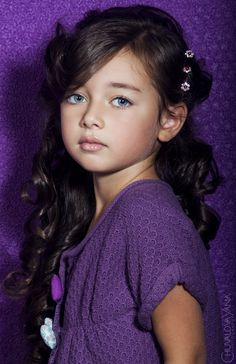 pretty in purple, don't care much for photoshop pics of kids but she is a beauty
