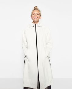 TECHNICAL ZIPPED RAINCOAT