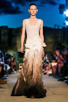 Accompanied by holy music, the models at the Givenchy spring/summer 2016 show came and came and came, some 80 in all, in lace and sequins, some plated like reptiles and some floating on enormous clouds of gown. (Photo: Guillaume Roujas/NOWFASHION)