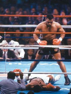 Mike Tyson knocks out Michael Spink in 91 seconds to maintain the IBF/WBA/WBC Heavyweight titles. (si.com)