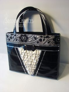 Several very fancy duct tape purses. These would be cute with some of the patterned duct tape.