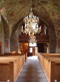 Husaby kyrka interiör  The paintings inside has survived time and war. And still stand.  Husaby, near Kinnekulle, is a village belonging to Götene Municipality in the province of Västergötland, Sweden. It is most known for the old stone church Husaby Church. Olof Skötkonung, the first Christian king of Sweden, is rumoured to have allowed himself to be baptised at a well by the church in 1008.