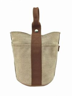 Hermes Canvas Saxo Pm Bucket Beige And Brown Tote Bag. Get one of the hottest styles of the season! The Hermes Canvas Saxo Pm Bucket Beige And Brown Tote Bag is a top 10 member favorite on Tradesy. Save on yours before they're sold out!