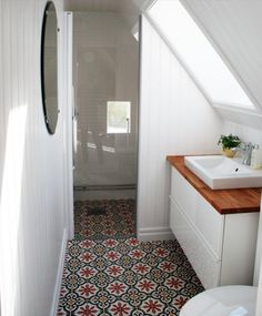 Beautiful tile floor. Love the continuation right into the shower