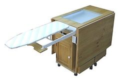 All in one : ironing station, folding cutting table, sewing machine table and storage and back lighted reproduction table!