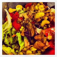 Salad with lettuce,peanuts,tomatoes and corn