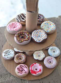 Play donuts made from wooden wheels. Love this. As flexible as felt is for making play food, I've found it tends to get really dirty and just collect every bit of hair and fuzz around
