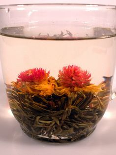 Eastern Sunrise from chinalifeweb.com // Highest grade blossoming tea. The green tea bud opens to reveal a red amaranth and yellow blossom. A light and refreshing infusion with a smooth finish.