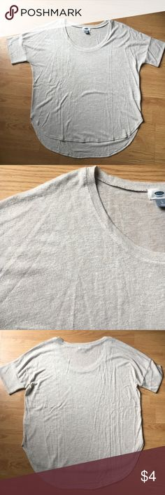 Old Navy- hi/low shirt Old Navy- hi/low hem- sz L- oatmeal colored- super soft almost cashmere sweater-like. There's a small almost unnoticeable stain at bottom hem on front. Priced lowest to reflect damage- I will make only $1 after Poshmark fees. Old Navy Tops Blouses
