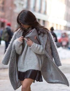 Lainy Hedaya is wearing a grey fuzzy sweater and coat from H&M and the skirt is 10 Crosby by Derek Lam