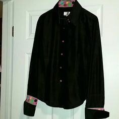 Andrea Becker button down sz Large Andrea Becker size Large, fitted  Black button down featuring pink bottoms Double button at collar, please see photos; cuffs and collar accented with large multi colored polka dots.  EUC from a smoke and pet free home  Please feel free to ask questions, and don't forget to bundle for discounts! Make an offer! Andrea Becker  Tops Button Down Shirts