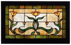 Stained Glass high window. Green trim, with three yellow and orange flowers.