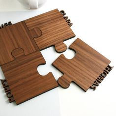 A set of four personalised, interlocking walnut jigsaw coasters.For personalisation please just add the names required in the box provided when ordering, each name will appear in capital letters, please note, we cannot produce symbols or emojis for this reason.Bring some fun to your home with these beautifully personalised jigsaw shaped walnut cut out jigsaw coasters. The ingenious design is not only a set of four individual coasters but the jigsaw shaped pieces fit together perfectly…