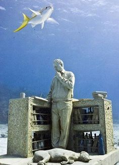 """Cancun Underwater Museum (MUSA), Mexico - British artist Jason de Caires Taylor's sculpture """"The Collector of Lost Dreams"""" ."""