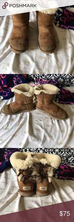 Bailey Bow Ugg Boots Chestnut bailey bow Ugg boots. Used. But still comfy and have a lot of life left in them!! Price reflects condition! UGG Shoes Winter & Rain Boots
