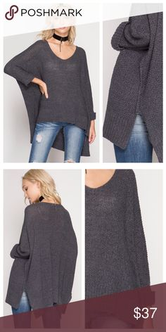 Gray Loose Fit V-Neck Sweater Gray sweater has a loose fit and slightly open weave (yes, wear something underneath!). Side slits and 3/4 length sleeves with folded cuffs. EVIEcarche Sweaters