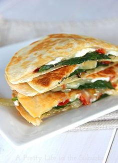 Goat cheese anything and we're all about it - Spinach & Goat Cheese Quesadillas with Caramelized Onions and Sundried Tomatoes {A Pretty Life}