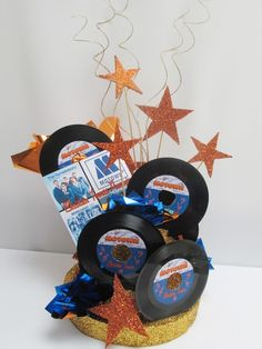This centerpiece includes: faux cake style base. Base measures round and high (stars extend above that in various heights) small records with a customized label, stars customized album cover Names and Number cutouts optional Music Centerpieces, Reunion Centerpieces, Party Centerpieces, Motown Party, 1960s Party, Retro Party, Sock Hop Party, Music Themed Parties, Music Party