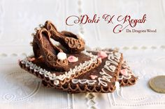 The high heel shoes, base and heels are cookies, the rest are royal icing. It is a special gift for a wonderful girl friend :)