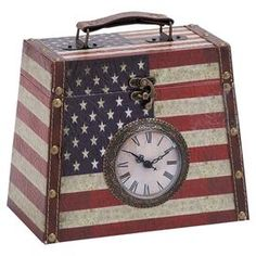 "Wood and leather box with functioning clock face and American flag motif.  Product: ClockConstruction Material: Wood and leatherColor: Antiqued red, white, and blueAccommodates: Batteries - not includedDimensions: 8"" H x 9"" W x 5"" DCleaning and Care: Wipe with a dry cloth"