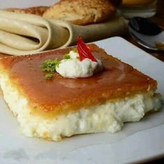 Knafeh/ A typical Lebanese dessert that is also served for breakfast. Perfect with a drizzle of syrup prepared using Al Wadi Al Akhdar all natural waters (rose water, orange blossom water) Lebanese Desserts, Lebanese Recipes, Turkish Recipes, Knafeh Recipe Lebanese, Persian Recipes, Lebanese Cuisine, Middle East Food, Middle Eastern Desserts, Arabic Dessert