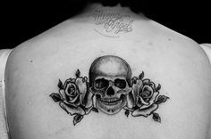 Skull and roses tattoo for upper thigh