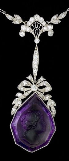 An Edwardian platinum and white gold necklace set with diamonds and a cameo cut amethyst. Circa 1910-1920