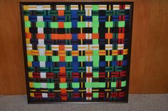 Karate Belt Wall Hanging....a great way to display rank belts...I made this with all of the belts that my kids and I earned.  Framing kit, hot glue, scissors, basic weaving skills and patience.