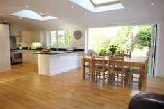 A beautiful kitchen/diner extension, with pine roof windows will add light and space to your home. We recommend safety glazing for high up installations, such as home or kitchen extensions. Image via Spicer McColl. Kitchen Diner Extension, Open Plan Kitchen Diner, Open Plan Kitchen Living Room, Kitchen Family Rooms, New Kitchen, Kitchen Ideas, Kitchen Extension Roof Lights, Island Kitchen, Awesome Kitchen
