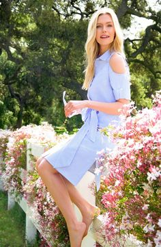 This classic, cold-shoulder shirtdress is made from crisp cotton which makes it perfect for sunny weather.