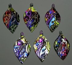 Use Alcohol Inks on embossed metals for an endless amount of colorful possibilities  #JewelryIdeas
