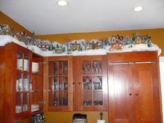 Christmas Kitchen Cabinets, Christmas on top of the cabinets, Cabinets decorated with Department 56 villages, Kitchens Design