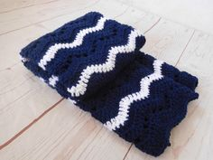 Navy blue baby boy Crocheted baby blanket. This is a very special handmade crochet baby blanket.  This baby afghan will make a wonderful baby shower gift.  This blanket would make a lovely addition to your baby nursery decor. Perfect also, for travel, strollers, prams, cribs, tummy time and photo props