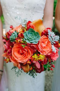 An orange rose, calla lily, and succulent bouquet