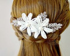 Beaded flower wedding hair comb by LaurenHCreations on Etsy  https://www.etsy.com/listing/229683208/french-beaded-flower-hair-comb-white