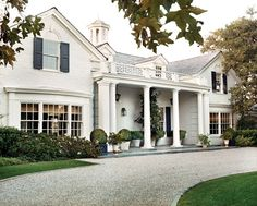 Front - columns, front porch, circular gravel drive. I will have this driveway someday!