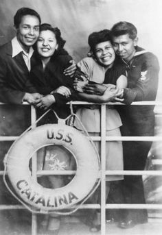 Here, two Mexican American men (at least one of whom is a serviceman) pose with their sweethearts in 1940. (The railing is an in-studio prop.)