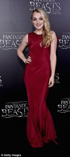 Red hot! Harry Potter actressEvanna Lynch, 25, smouldered in a figure-hugging deep burgun...