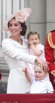 The Duchess of Cambridge in her white Alexander McQueen coat dress at the Trooping the Col...