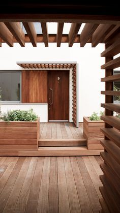 Tottenham Court Road residential courtyard (ESA) // Nigel Height // wood entry screen and planters