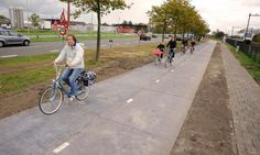 Solar panels embedded in the cycle path near Amsterdam could generate enough electricity to power three houses, with potential to extend scheme to roads