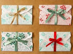 DIY Network has instructions on how to simply wrap gift cards using colored origami paper and small paper doilies.