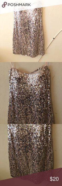 Glitz, Glam,Girly Pink Sequin Dress I wore this for my unicorn Halloween costume and once for New Year's Eve. I felt so girly and pretty in this dress. It's light if you want to dance in it and perfect to catch the eye of any cutie you meet. AUW Dresses Mini