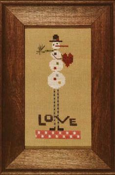 Heart In Hand Needleart Leggy Snowman - Cross Stitch Pattern. Model stitched on 32 count Dirty Belfast linen using Weeks Dye Works & Gentle Art. Stitch count: 3