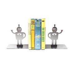 Who says robots can't love? These sweet guys are handmade from metal to support your books using the buddy system.