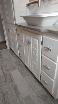 nautical kitchen with two toned cabinets boat cleats for drawer