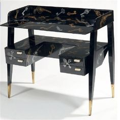 """""""Chiavi e pistole""""  Gio Ponti & Piero Fornasetti    Small writing desk with four drawers.  Lacquered wood with gold and silver leaf, lithography transfer.  Brass sabots and resin handles.  Cm 92x45 - H. cm 85.  Designed by Gio Ponti and executed by Fornasetti, mid 1950's."""